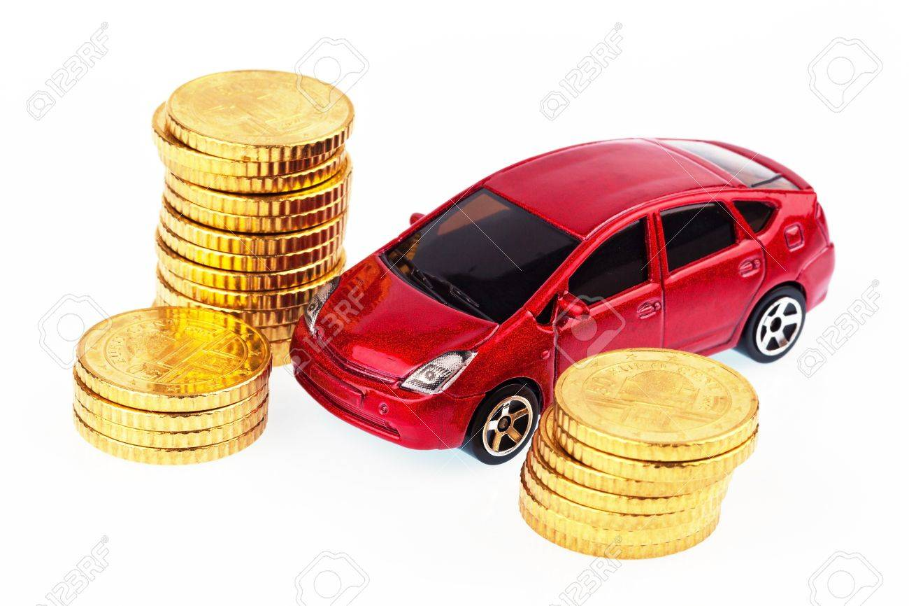 A Model Car And Coins Against White Background, Photo For Price ...