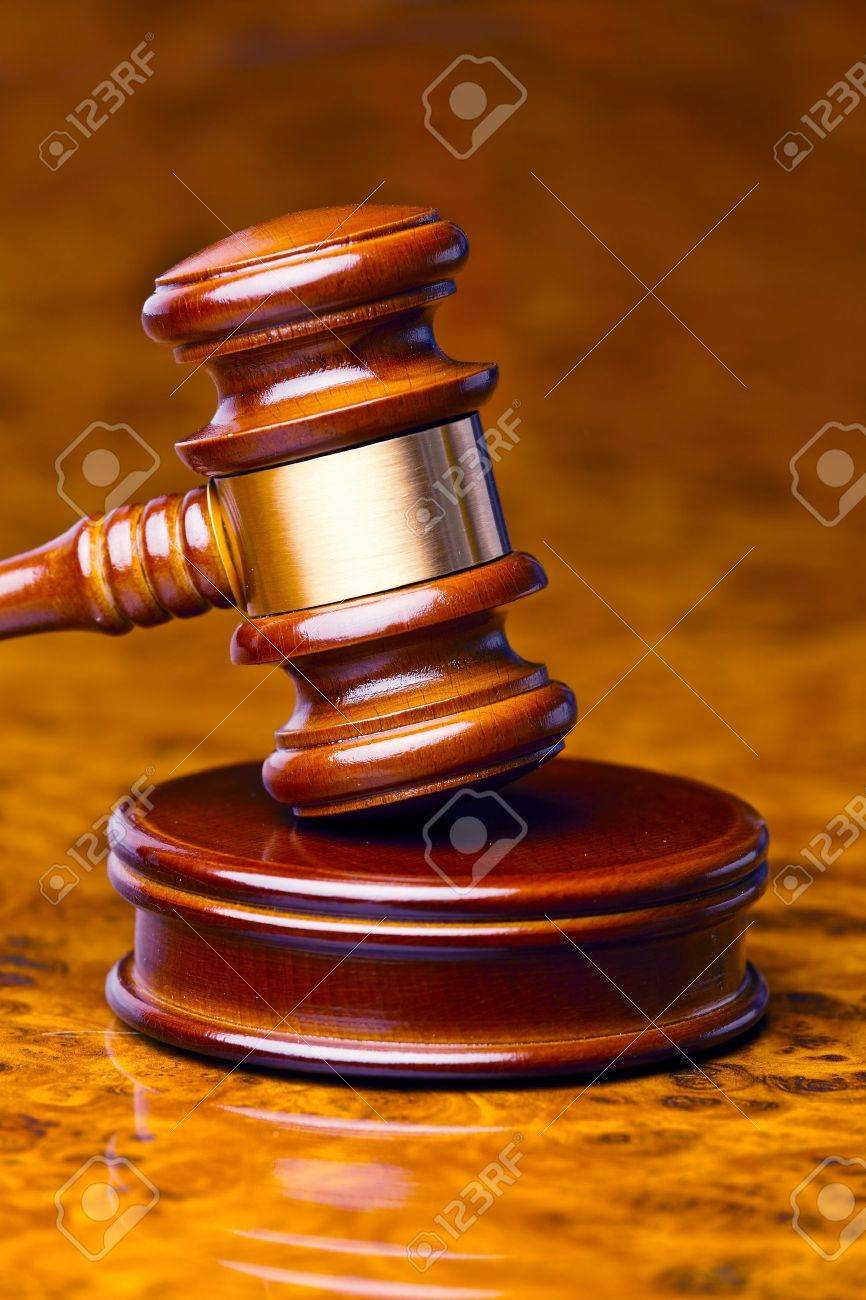 the gavel of a judge in court  lies on a desk Stock Photo - 13848610