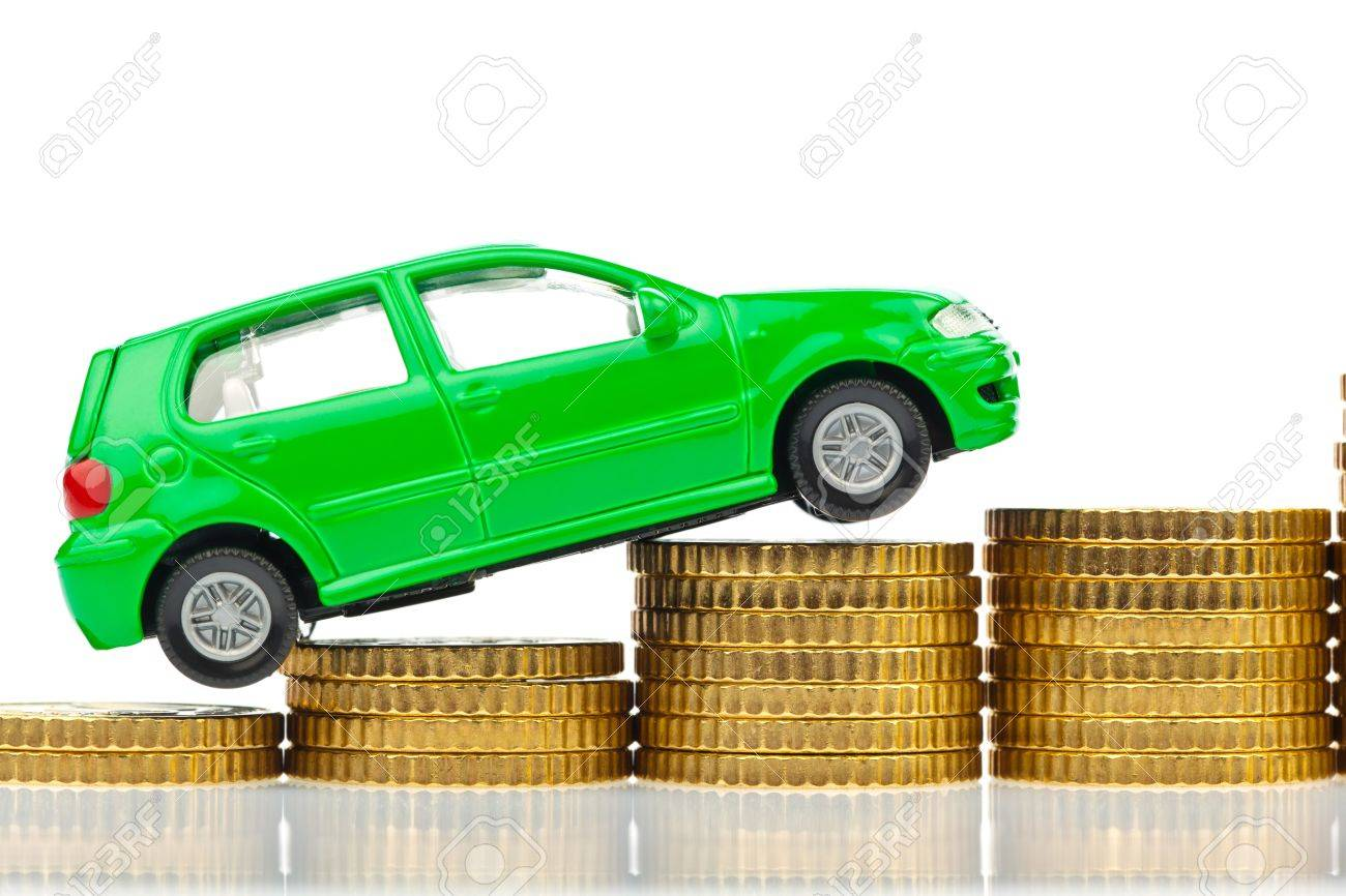 A Model Car Is On Coins Rising Costs For Gasoline Car Prices ...