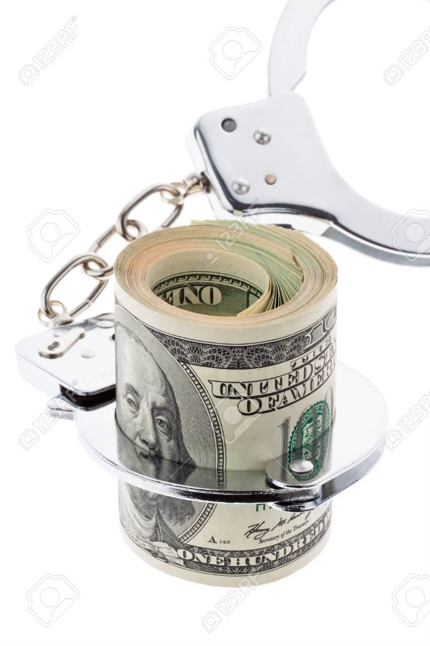 many dollar bills with handcuffs Stock Photo - 14414956