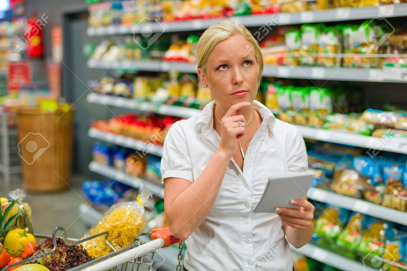 a woman is overwhelmed by the huge selection when shopping in a supermarket Stock Photo - 14468083
