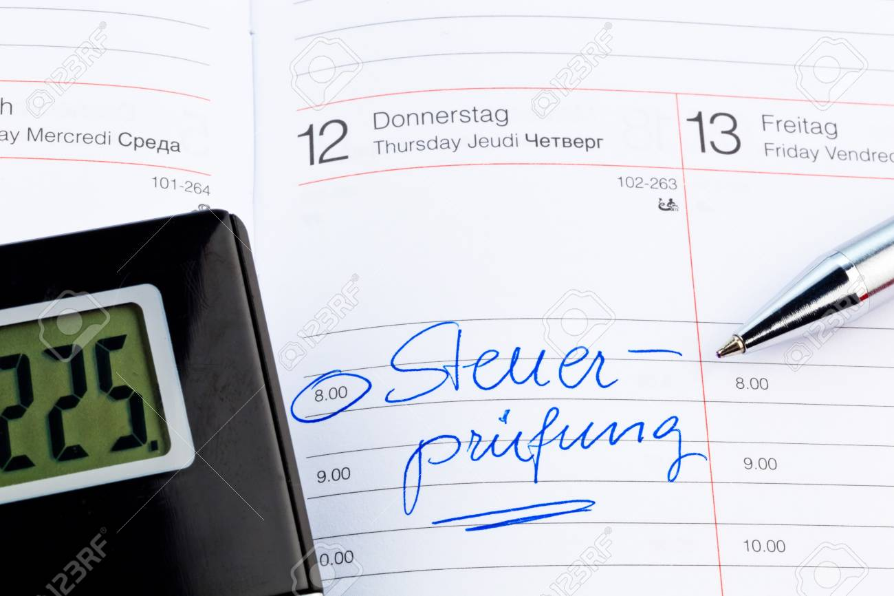 an appointment is entered on a calendar  tax audit Stock Photo - 14563301