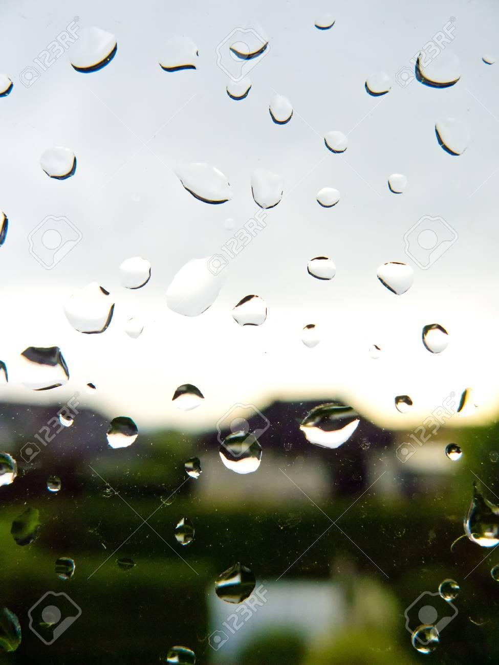 many rain drops during bad weather on a window pane  rainy weather Stock Photo - 14563467
