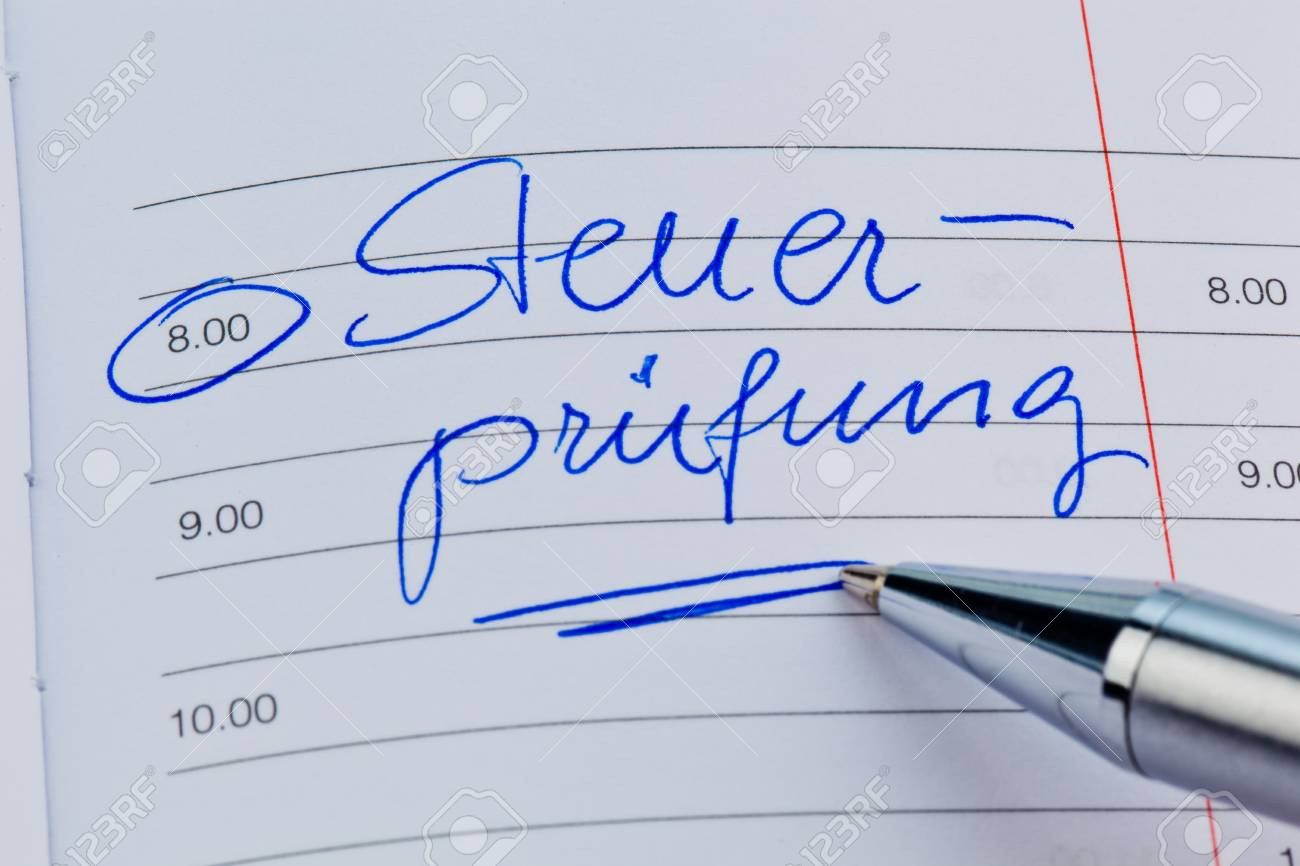 an appointment is entered on a calendar  tax audit Stock Photo - 14563470