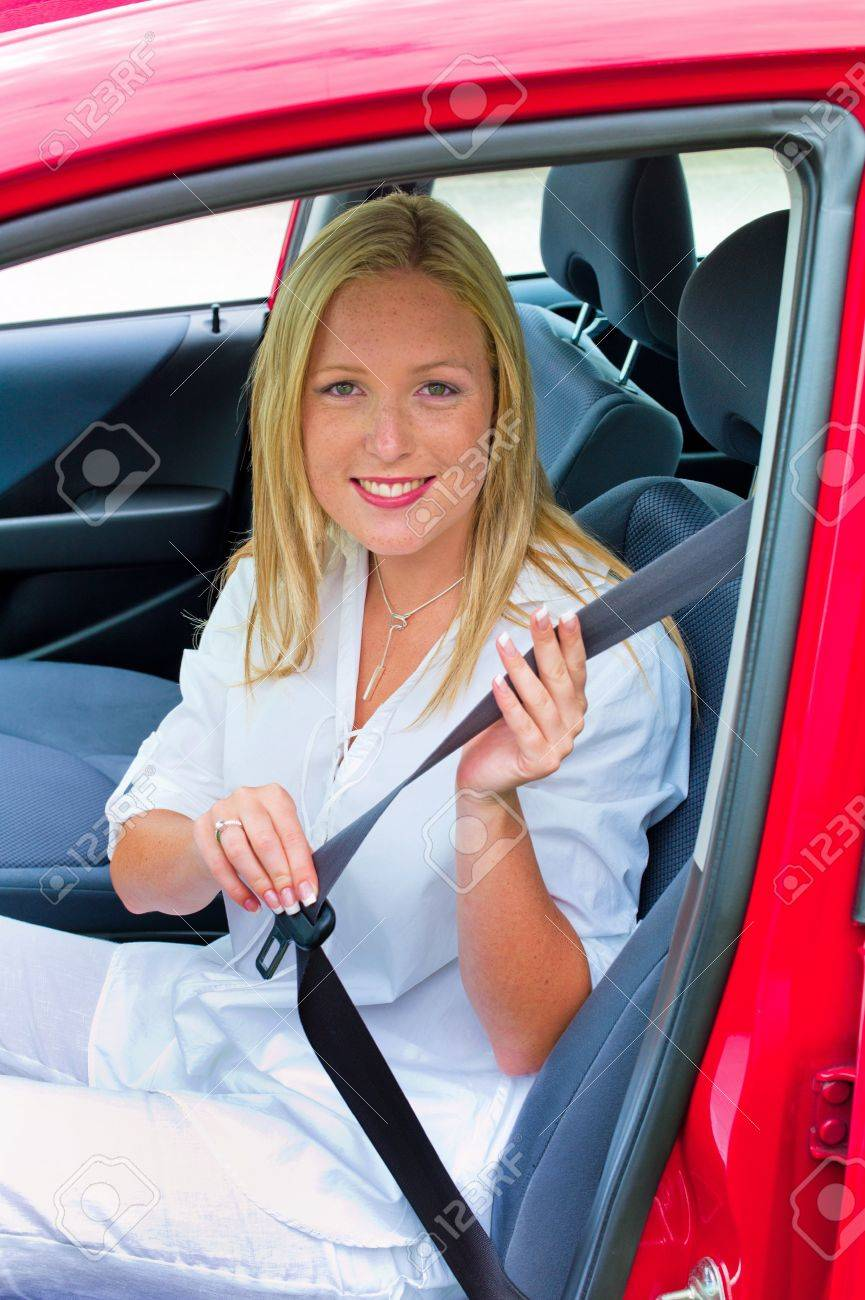 a young woman taped and reeled before riding in a car with the seat belt Stock Photo - 14587366