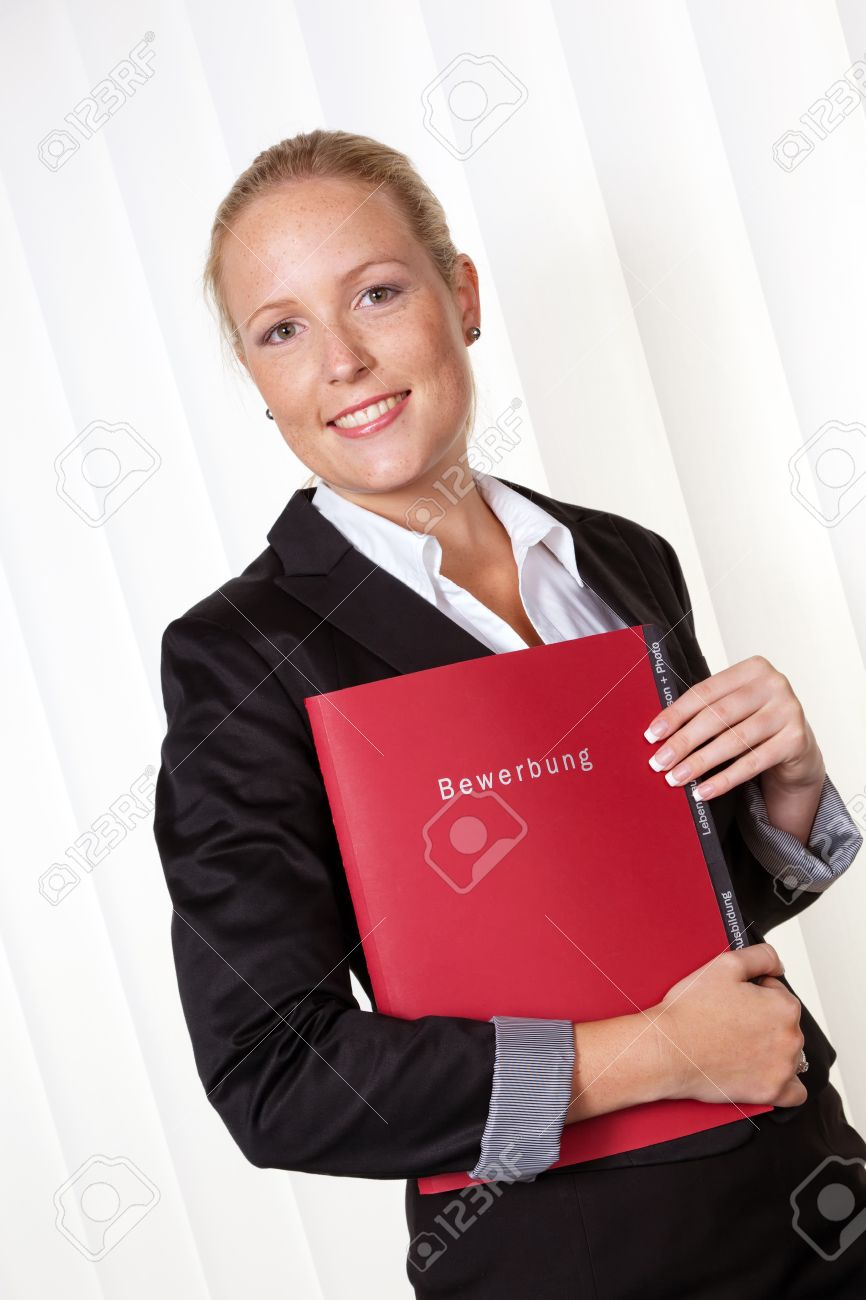 a woman in business attire with a job application  proper clothing for the interview Stock Photo - 14587313