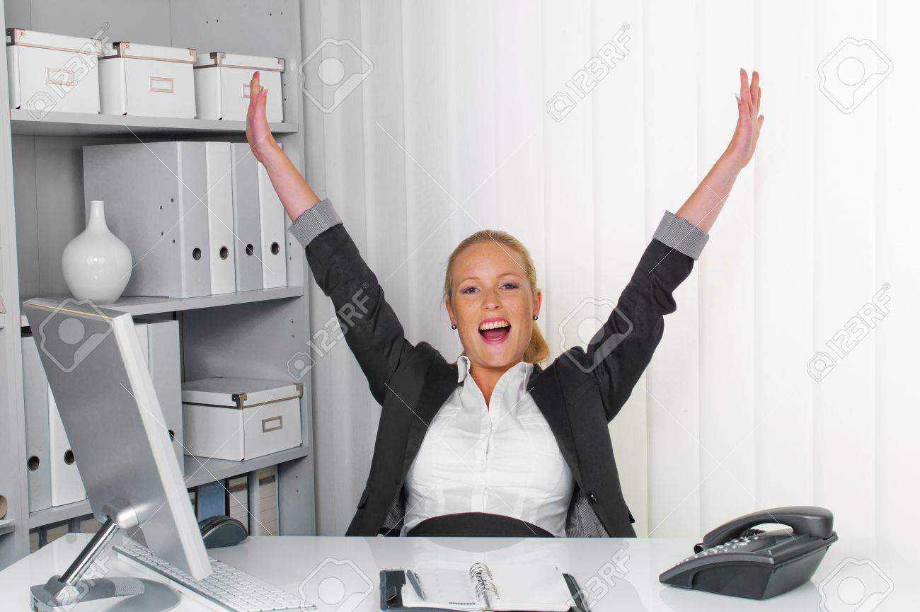 a young successful woman sitting at her desk in the office Stock Photo - 14587324