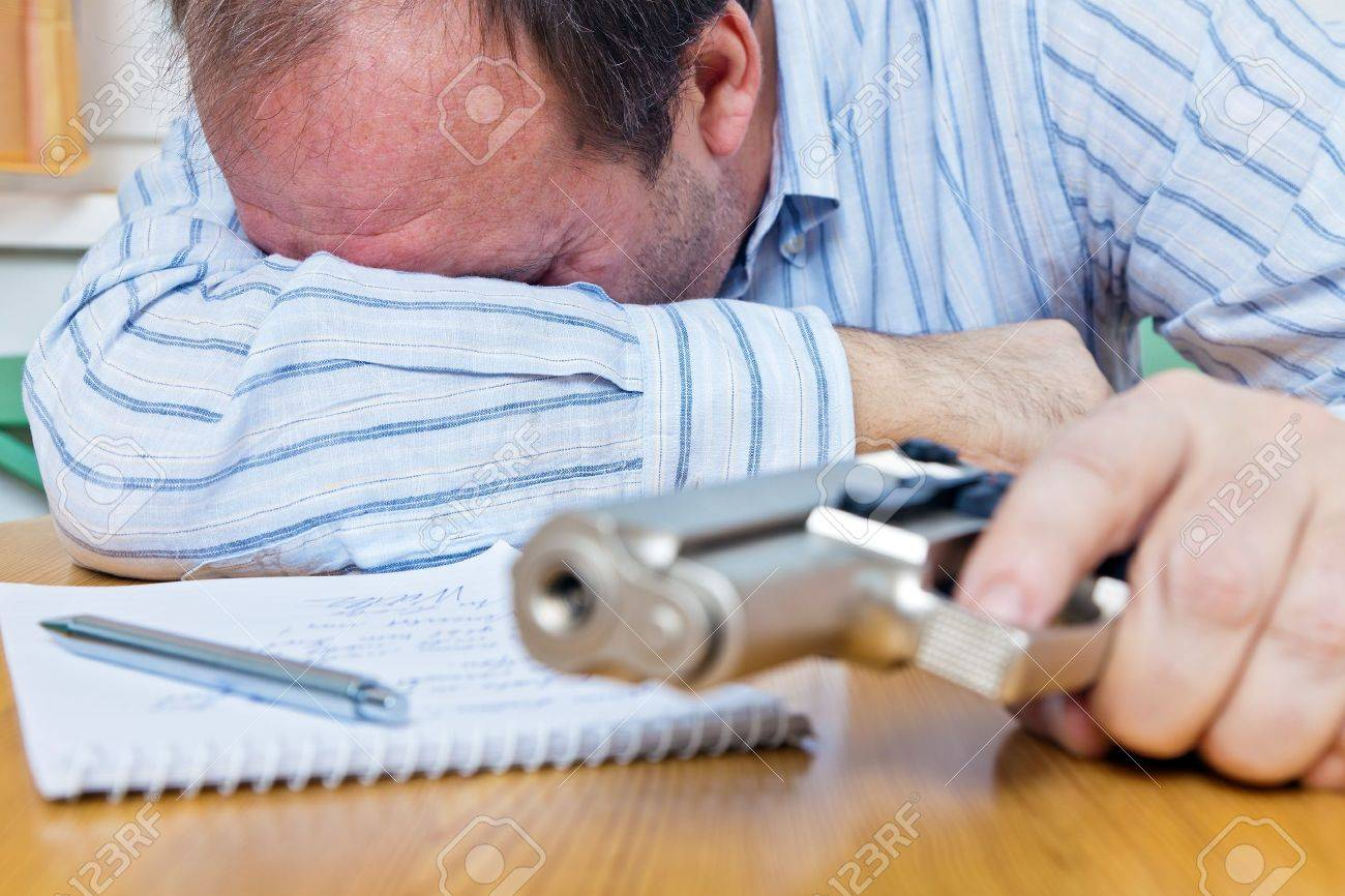 a farewell letter and the gun of a suicide Stock Photo - 15512873