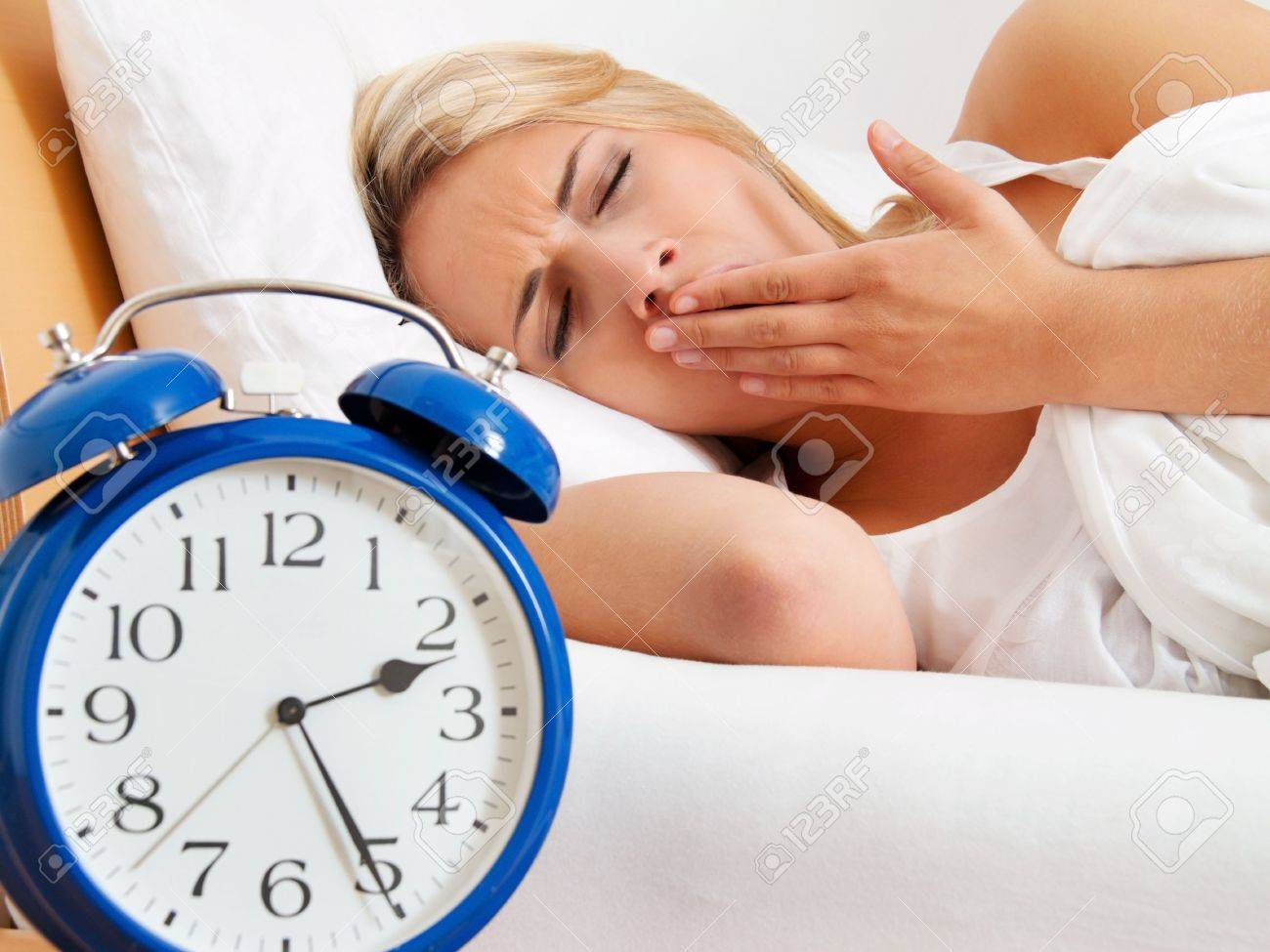 insomnia with clock in the night  woman can not sleep Stock Photo - 16379135