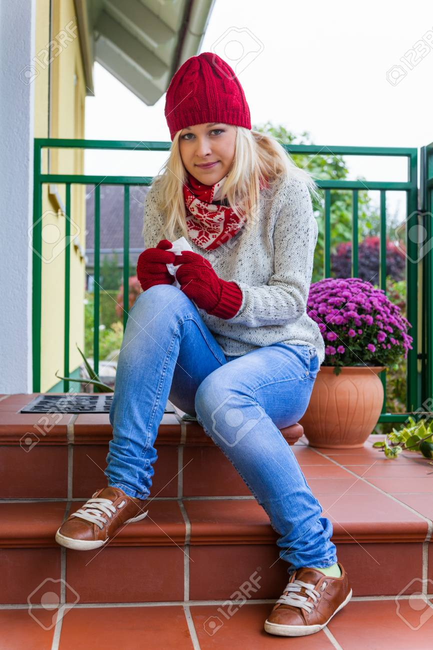 a young woman has a cold and has a cold  autumn is the time for flu, colds and flu Stock Photo - 16469456