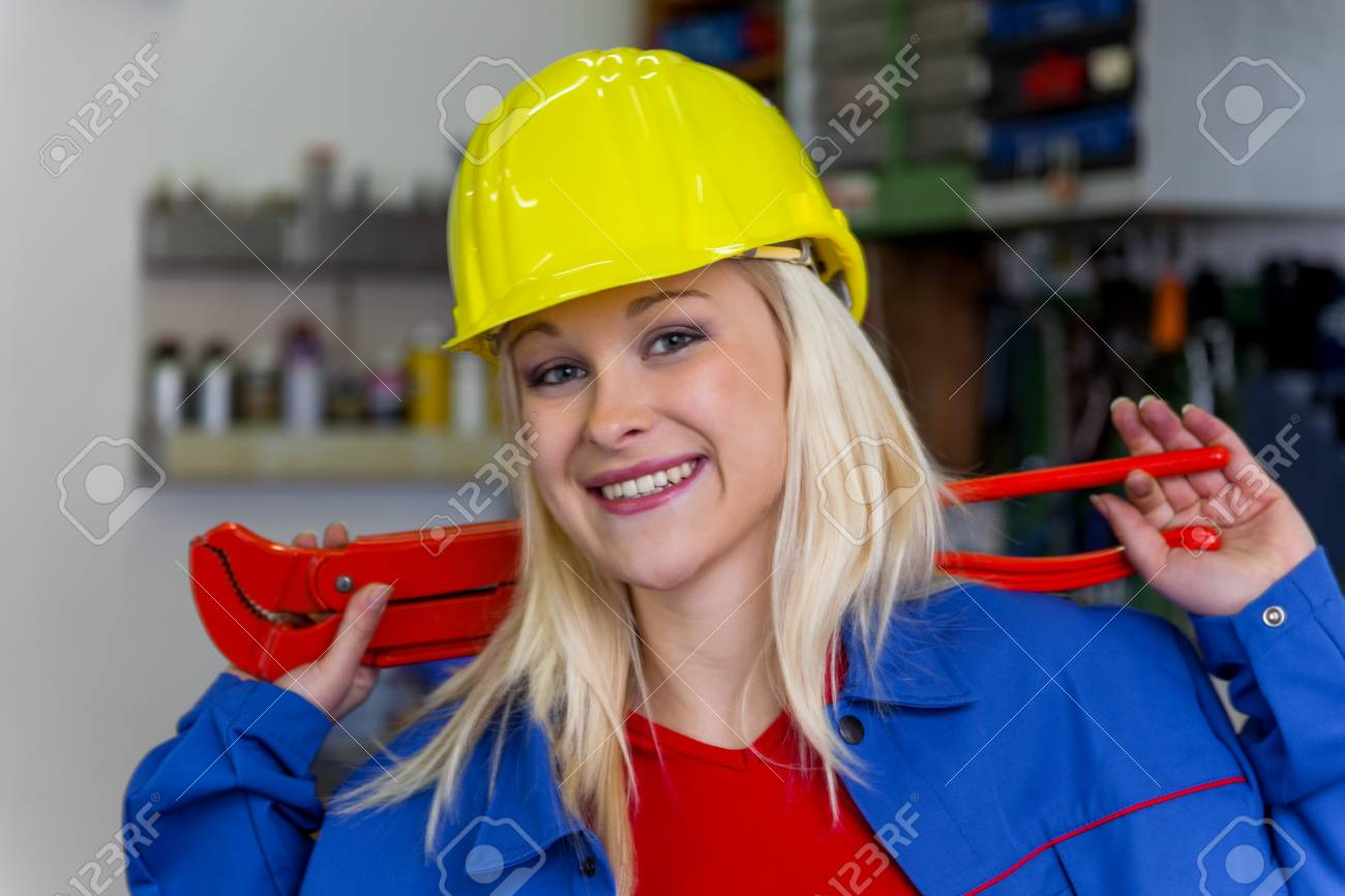 young mechanic with yellow helmet and wrench in a workshop  rare female occupations Stock Photo - 16469373