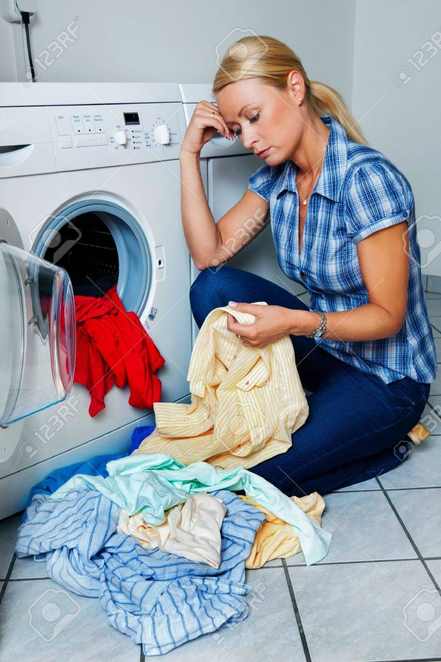 a young housewife with washing machine and clothes  laundry day Stock Photo - 17634720