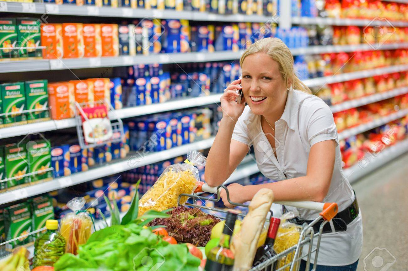 a woman when buying food in a supermarket  everyday life of a housewife Stock Photo - 18053150