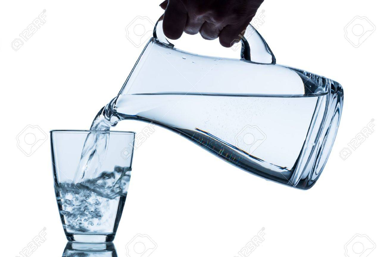 pure water is emptied into a glass of water from a pitcher  fresh drinking water Stock Photo - 19088629