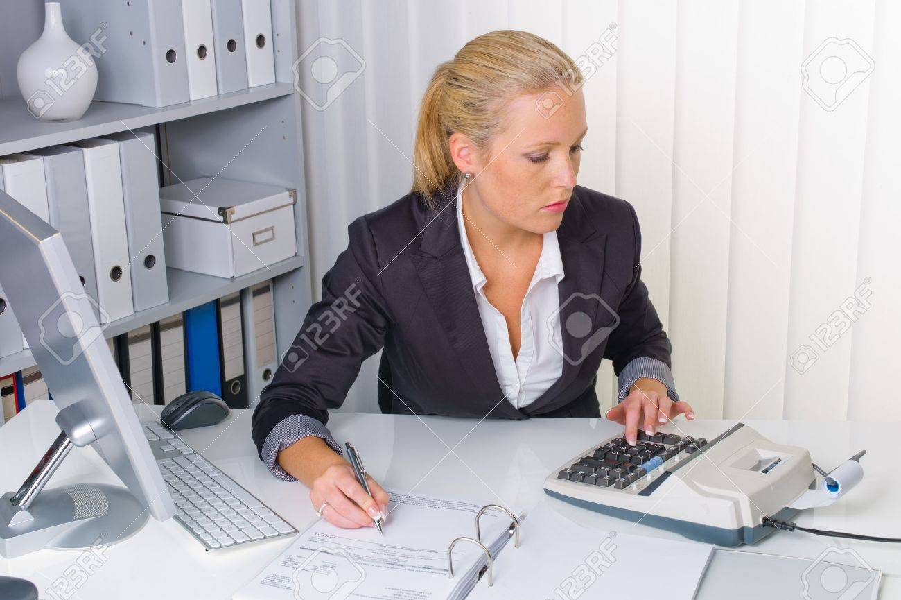 Stock Photo   An Accountant At Work In The Office With Calculator