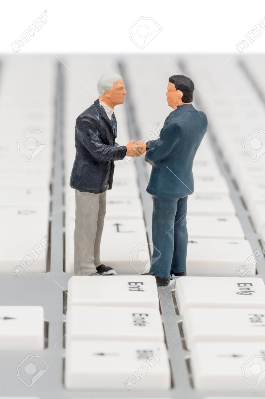 two managers entertain on the keyboard of a computer standing Stock Photo - 20771993