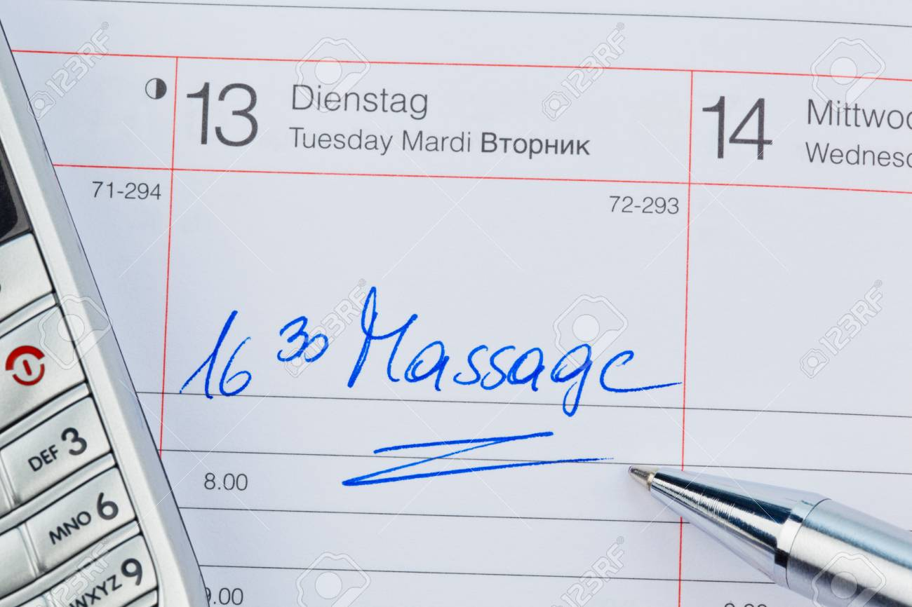 a date is entered in a calendar: massage Stock Photo - 22800674
