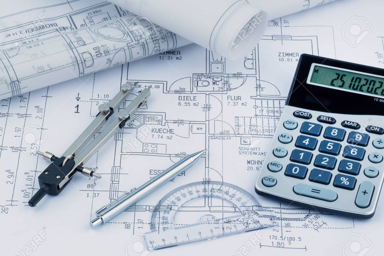 An architects blueprint with a calculator symbolic photo for an architects blueprint with a calculator symbolic photo for funding and planning of a new malvernweather Images