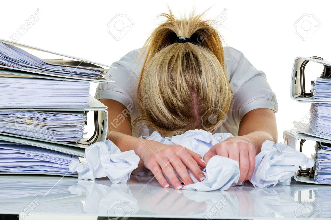 young woman in office is overwhelmed with work burnout in work or study - 26461138