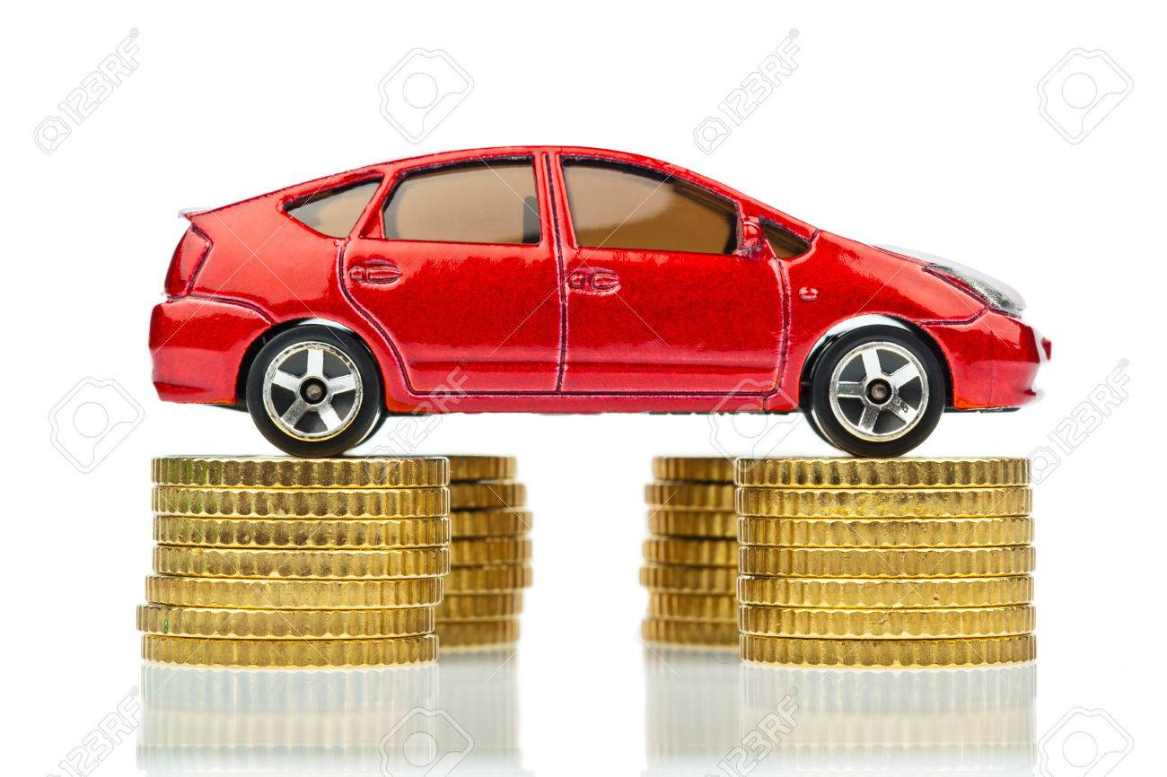 A Model Car Is On Coins. Rising Car Costs Higher Fuel Prices ...