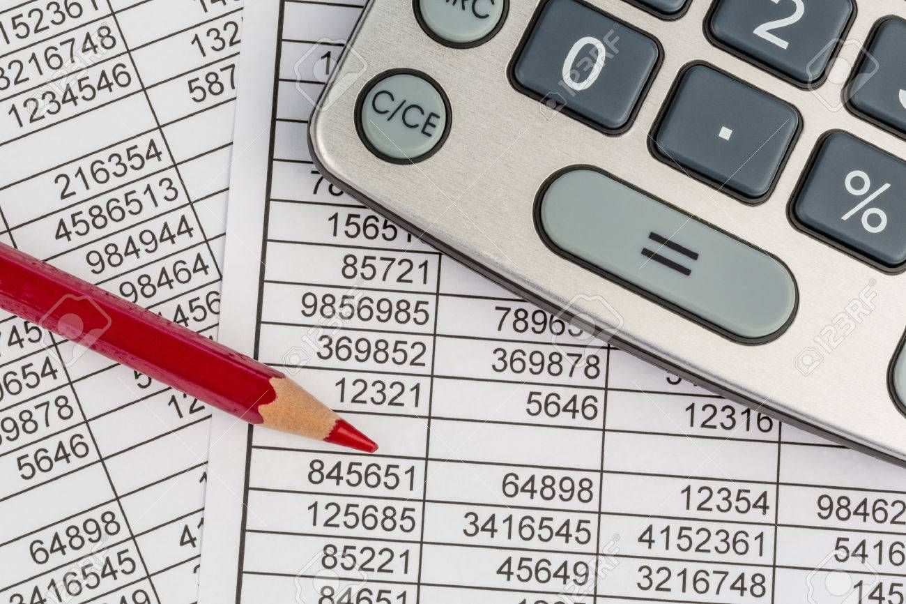 a calculator is on a balance sheet figures are statistics. photo icon for sales, profit and cost. - 30360997