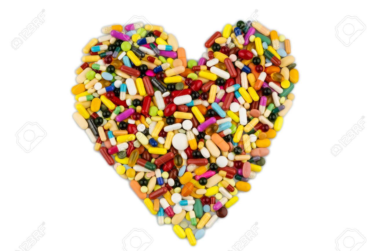 Colorful Tablets Arranged In Heart Shape Symbol Photo For Heart