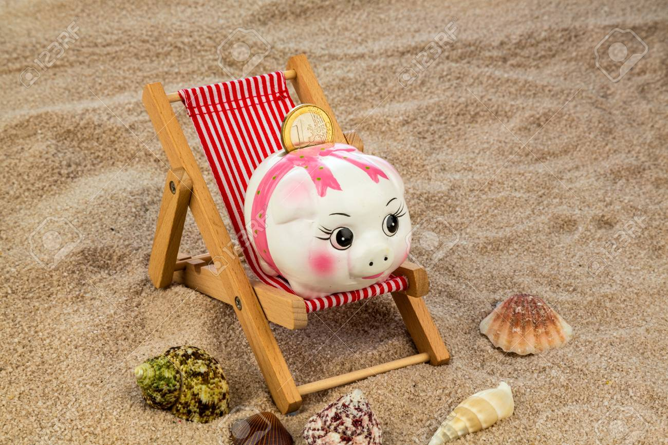Beach chair with euro currency on the sandy beach symbol photo beach chair with euro currency on the sandy beach symbol photo for costs in travel buycottarizona Choice Image
