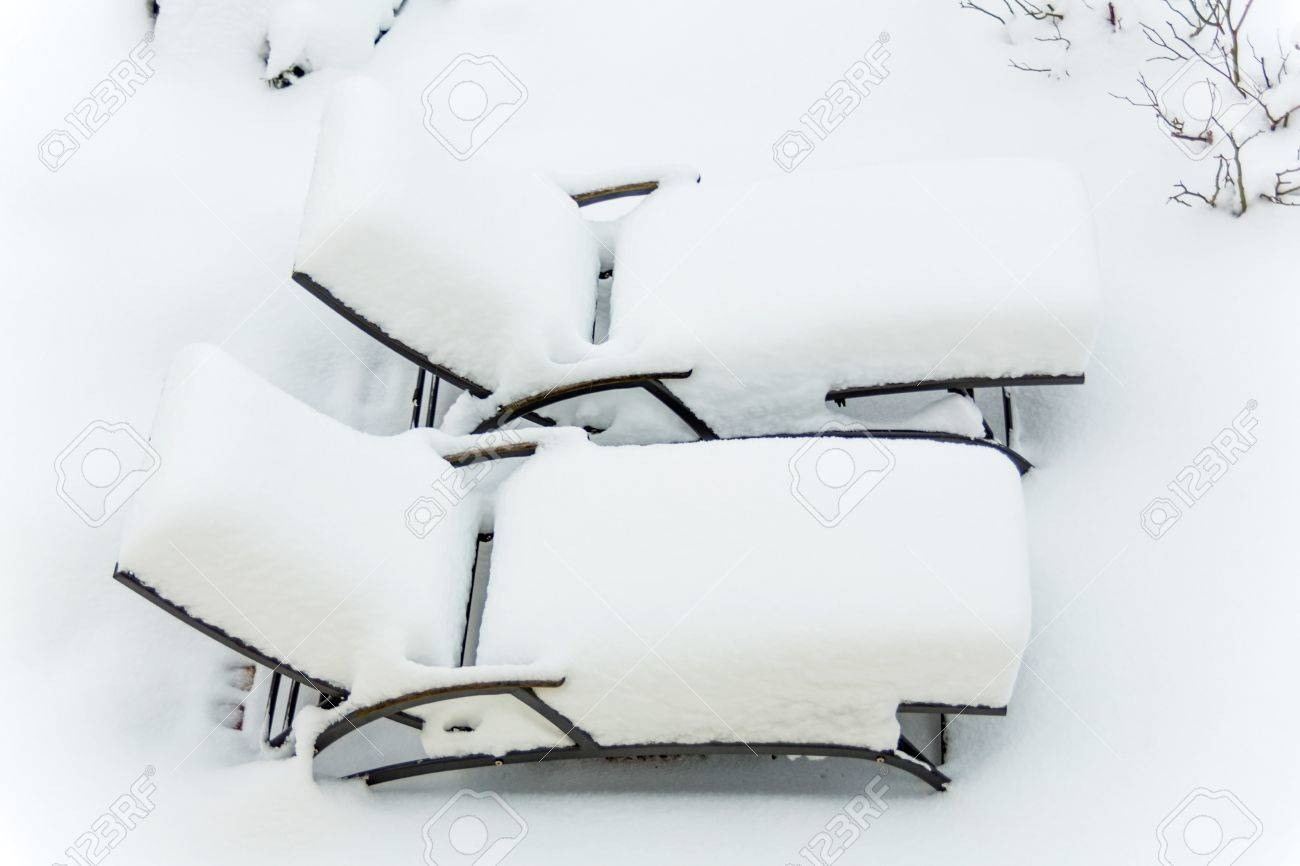 snow covered garden furniture symbol photo restaurants and hotels