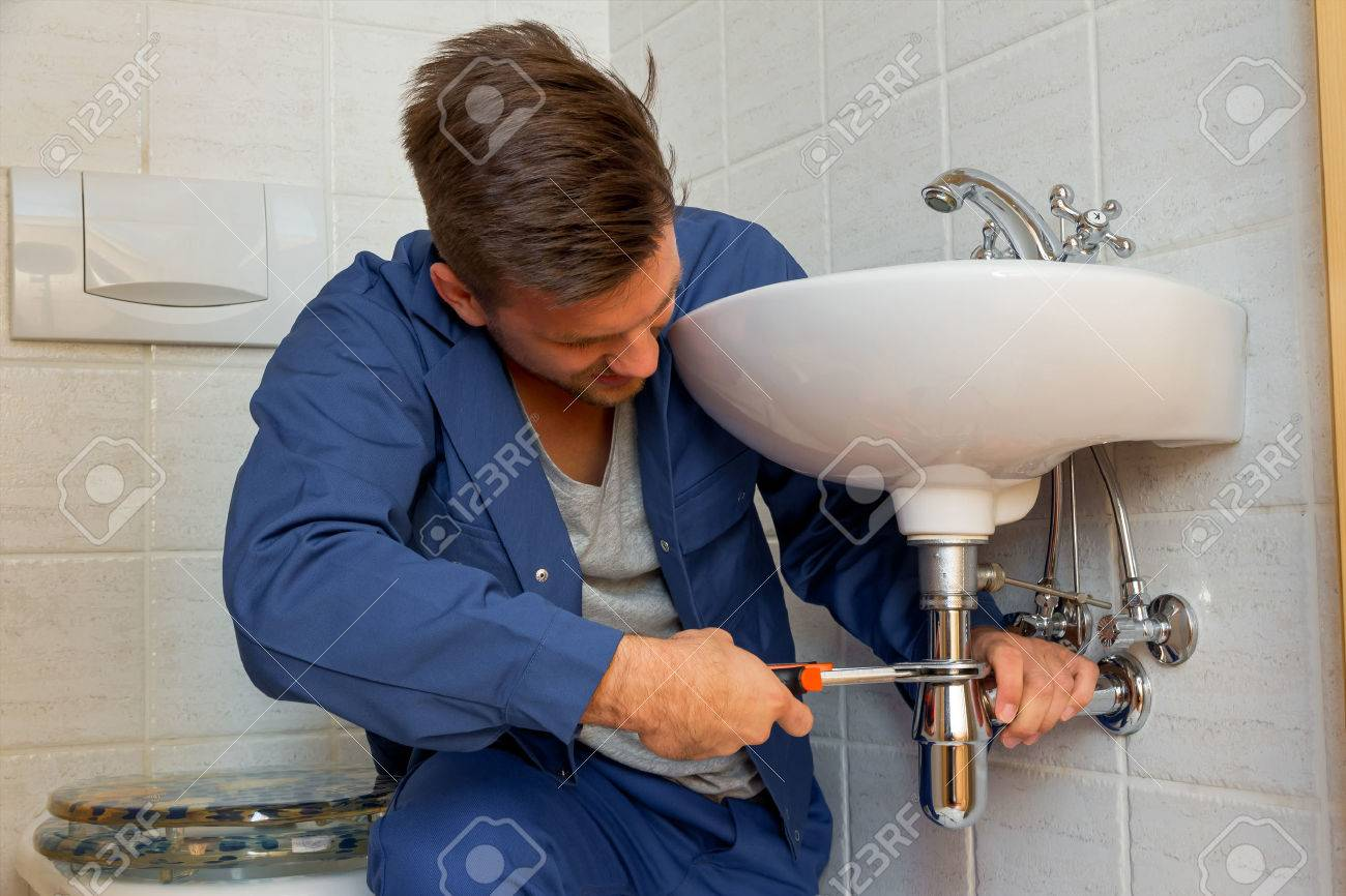 a plumber  at work Stock Photo - 38257859