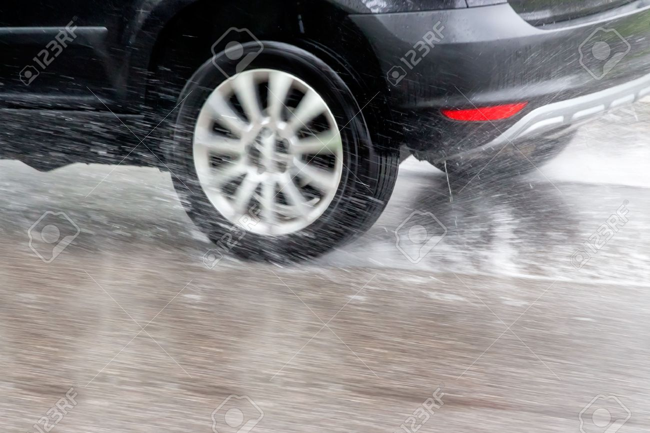 Car driving in the rain on a wet road. danger of aqua planning and accidents - 39281145