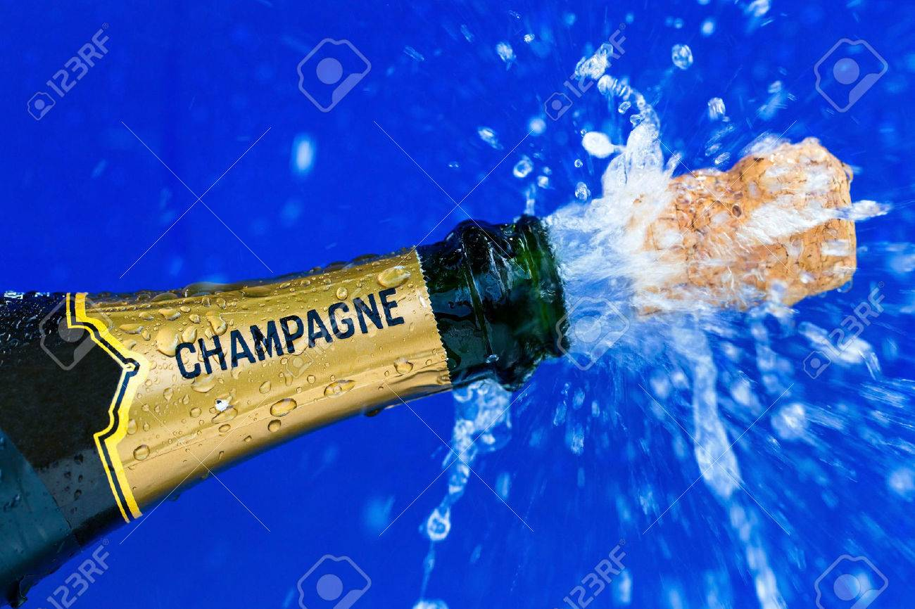 champagne bottle is opened. cork shoots from champagne bottle. symbolic photo for the year, new years eve, celebrations and openings. Stock Photo - 39706813