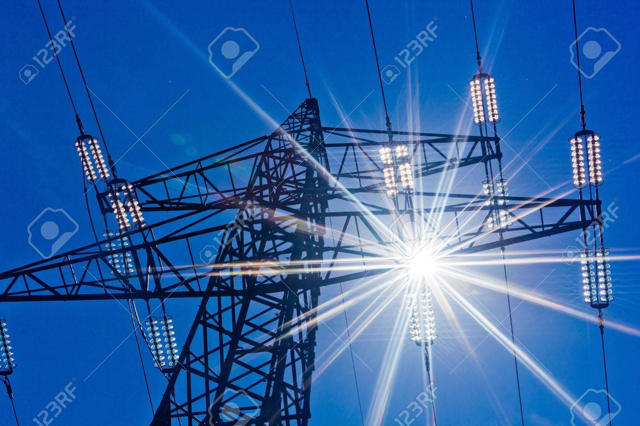 a high voltage towers for power against blue sky and sun rays Stock Photo - 39799306