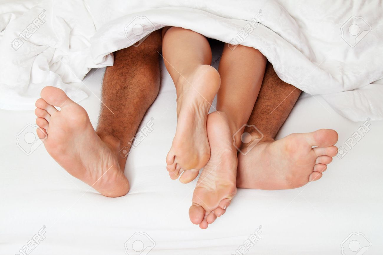 A couple feet in bed. love, eroticism and partners. Stock Photo - 40504558