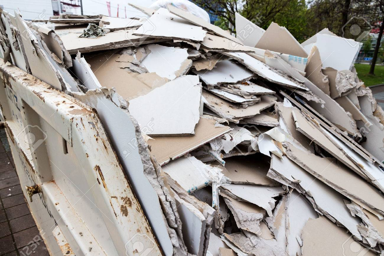in a waste container stacks sheets of plasterboard for their disposal Stock Photo - 40621801