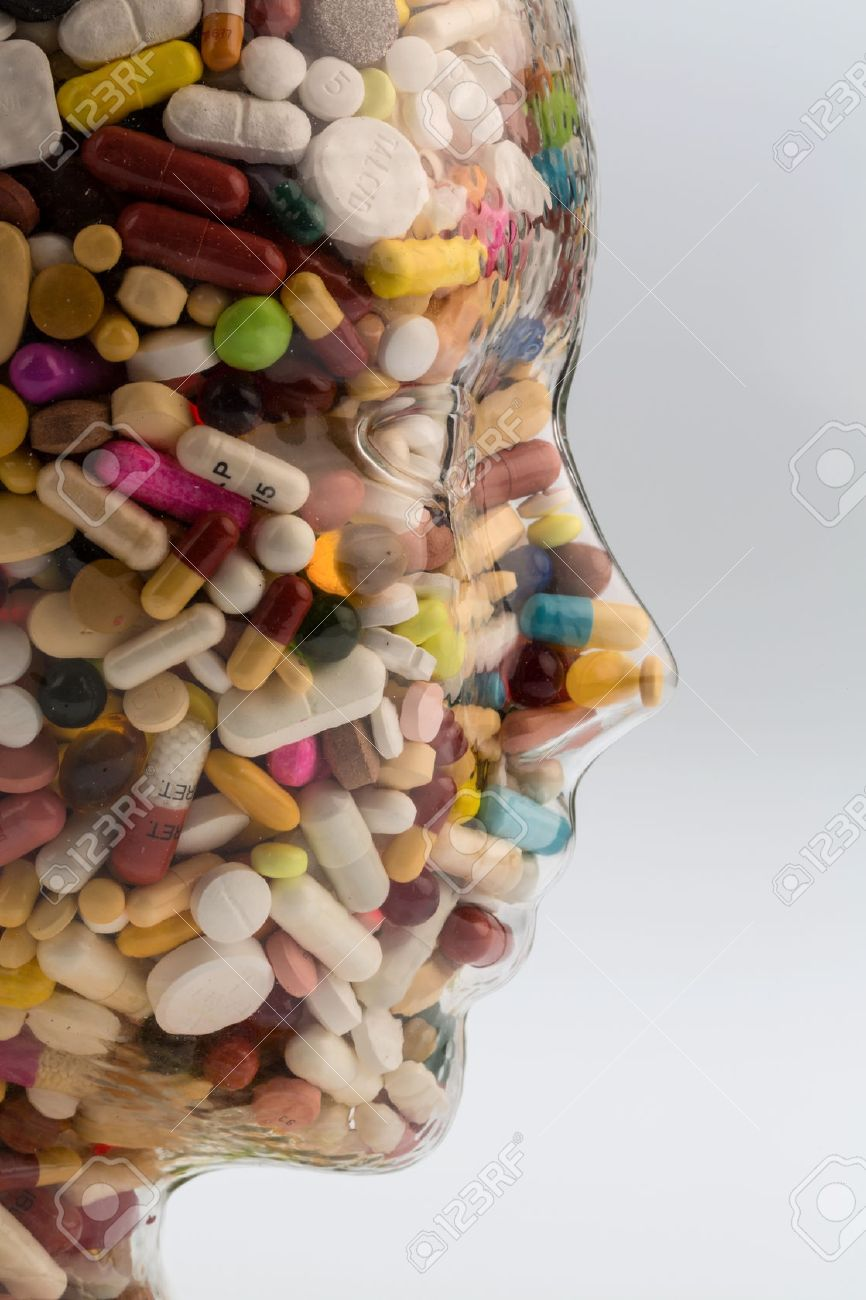 a head made of glass filled with many tablets. photo icon for drugs abuse and painkillers. Stock Photo - 44529652