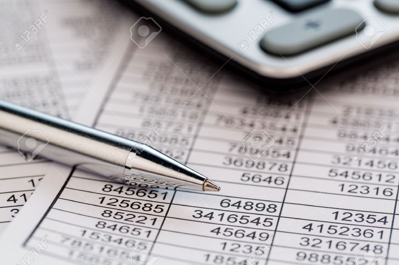 a calculator is located on the numbers a balance us statistics. photo icon for sales, profits and costs. Stock Photo - 45349818