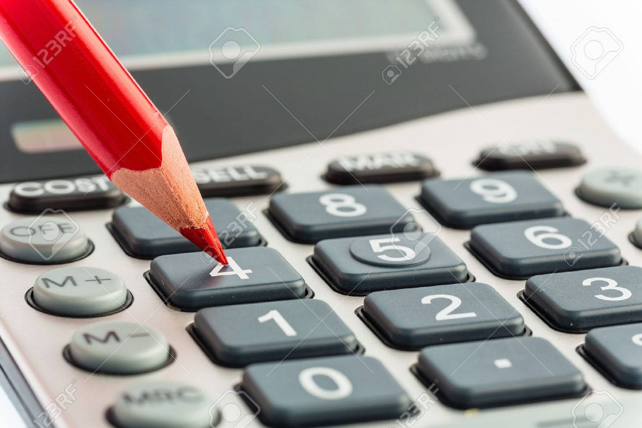 a red pen is on a calculator. save on costs, expenses and budget for bad economy Stock Photo - 45507519