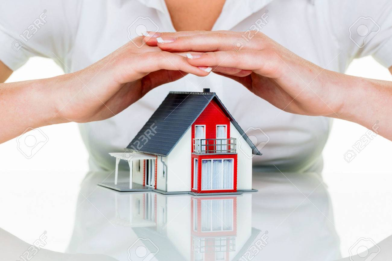 a woman protects your house and home. good insurance and reputable financing calm. Stock Photo - 45507983