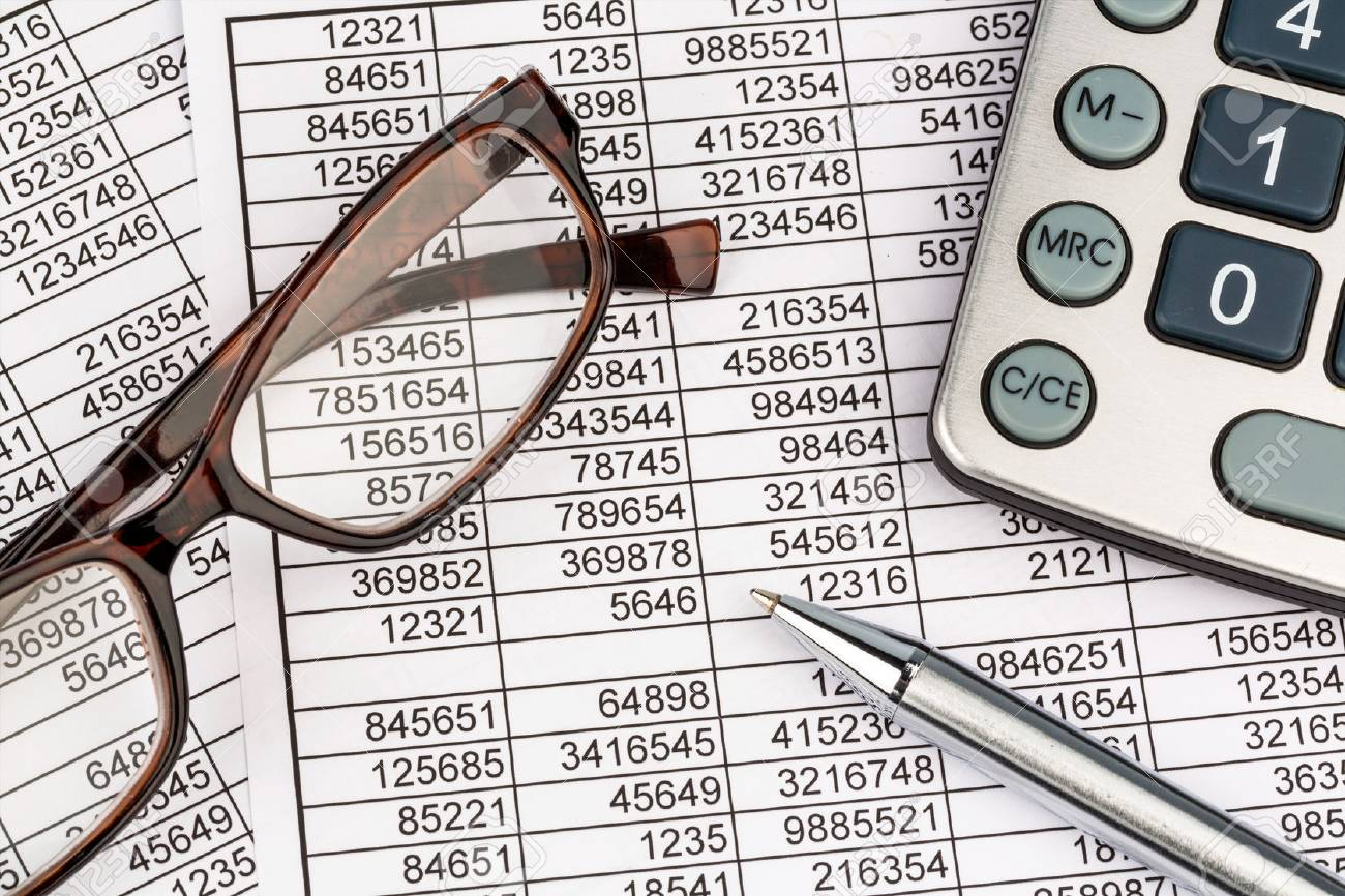 a calculator is located on the numbers a balance us statistics. photo icon for sales, profit and cost. Stock Photo - 46711660