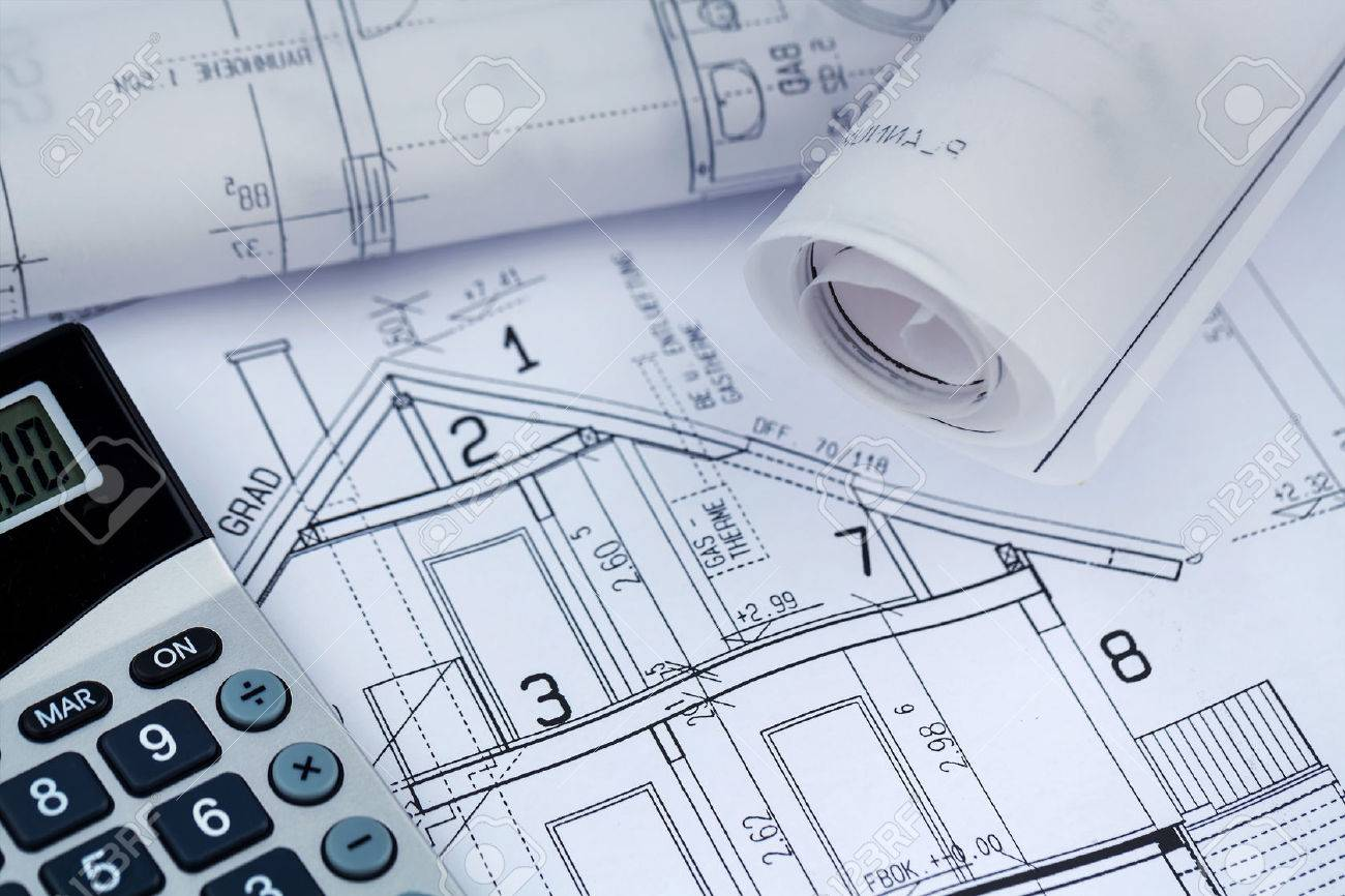 a blueprint of an architect with a calculator. symbolic photo for financing and planning of a new house. Stock Photo - 49135066