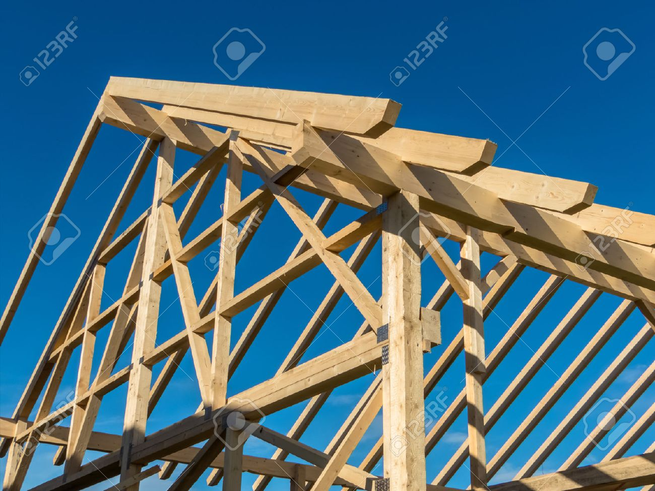 in one house a new roof is being built on a construction site. cleats, wood for roof trusses. Stock Photo - 50593384