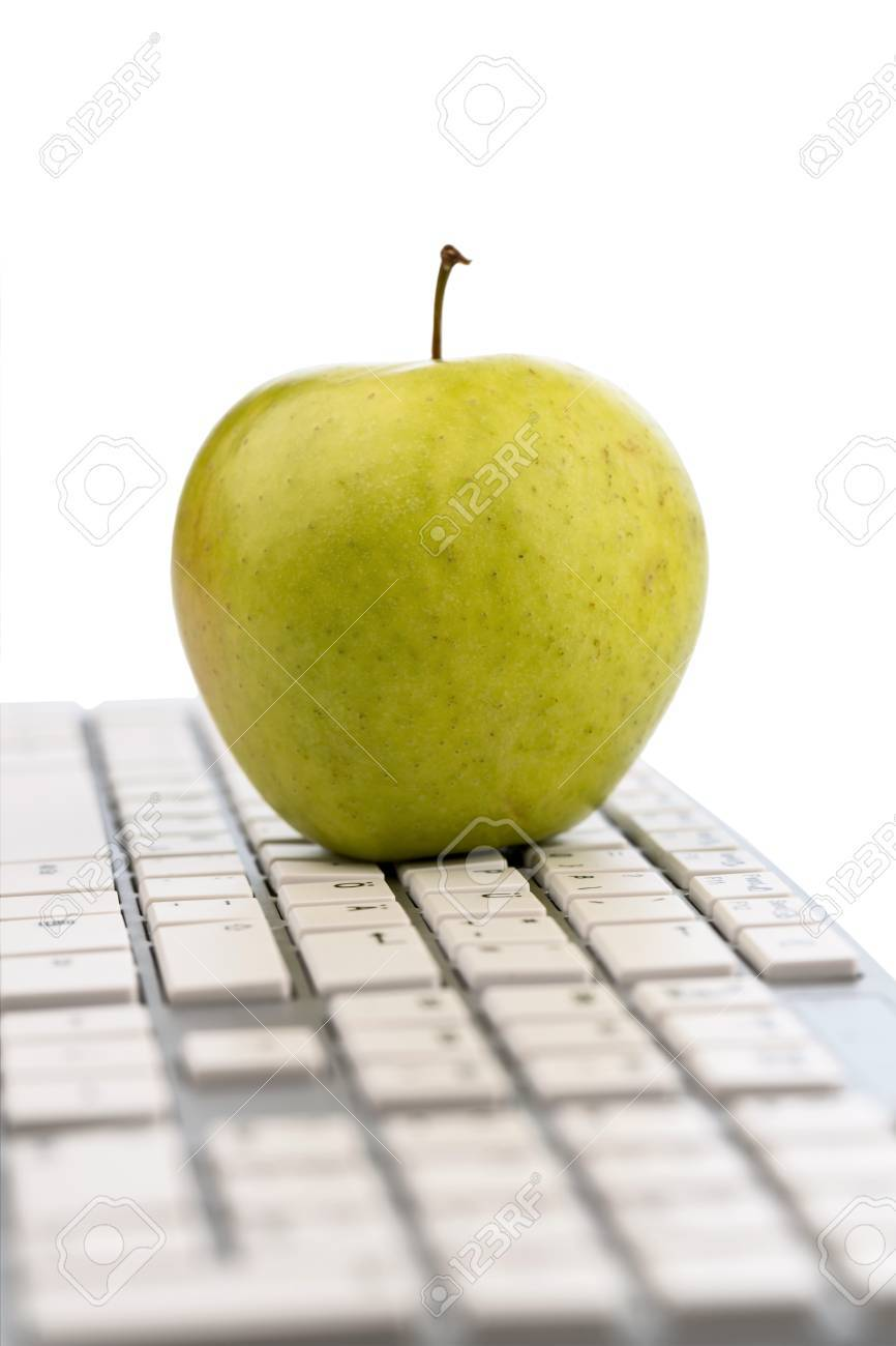 An Apple Is On The Keyboard Of A Computer Symbol Photo For Healthy