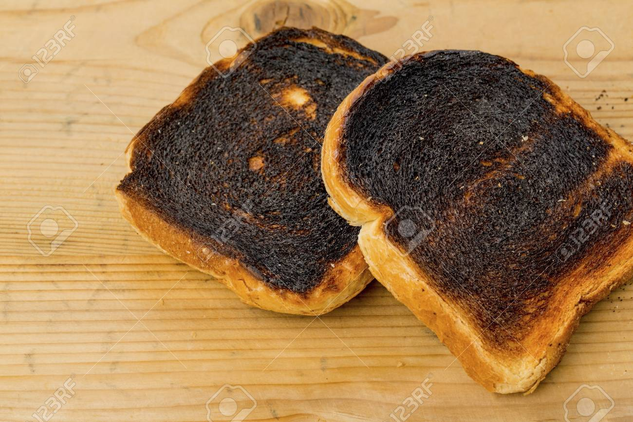 Toasted Bread Was Burned While Toasting. Burnt Slices Of Toast.. Stock  Photo, Picture And Royalty Free Image. Image 89935441.