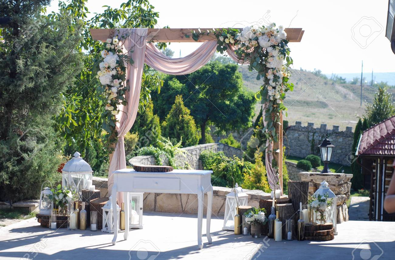 Beautiful Wedding Ceremony Outdoors. Wedding Arch Made Of Cloth ...