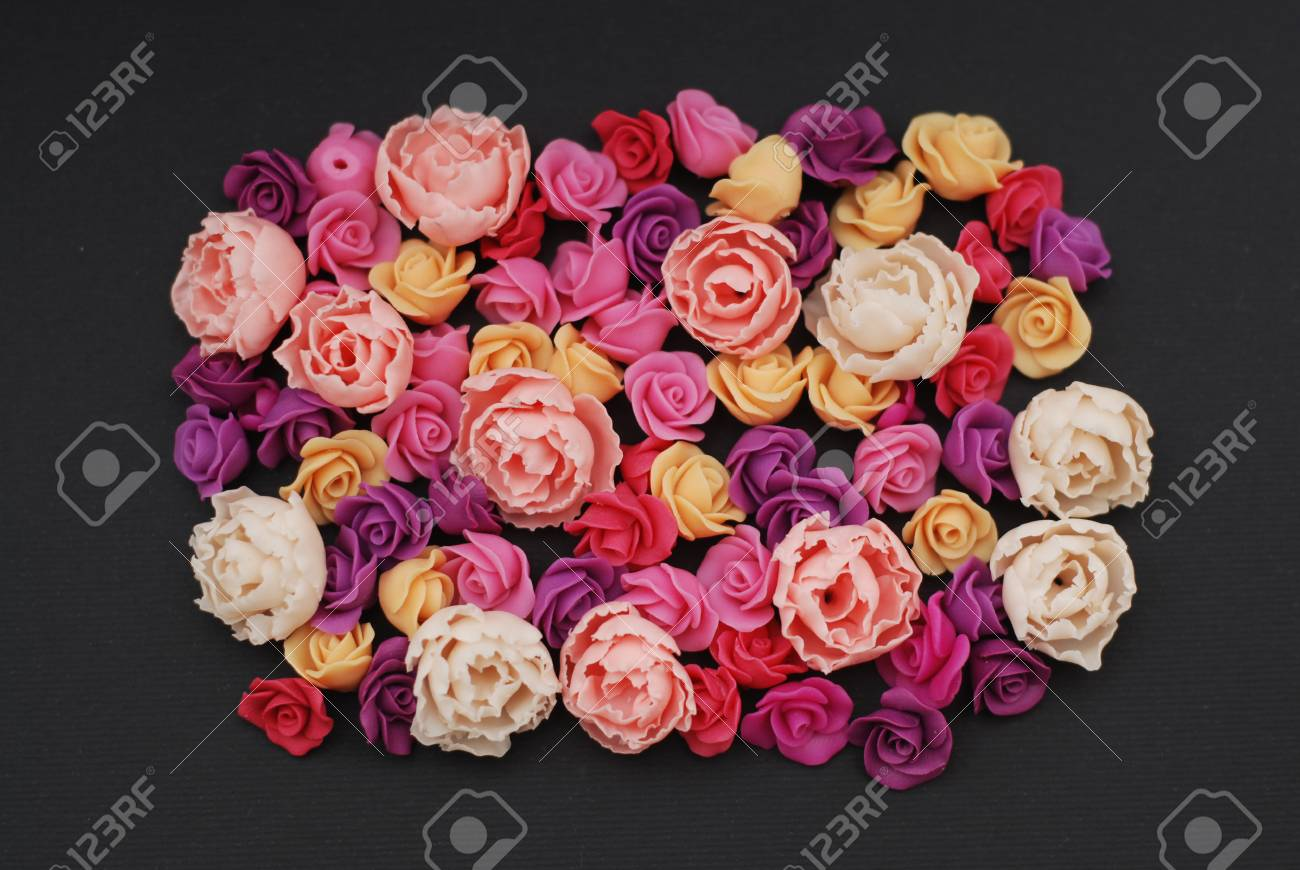 Mix Of Pink And Peach Fake Plastic Mini Rosess Flowers Black Stock