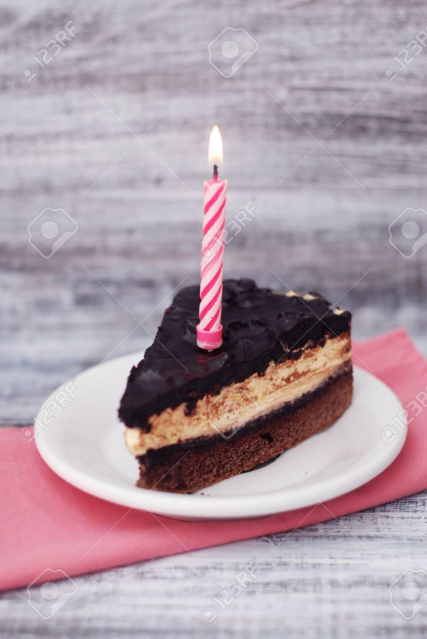 Sensational Chocolate Cake With Candle Piece Of Desert Birthday Cake Isoalted Personalised Birthday Cards Petedlily Jamesorg
