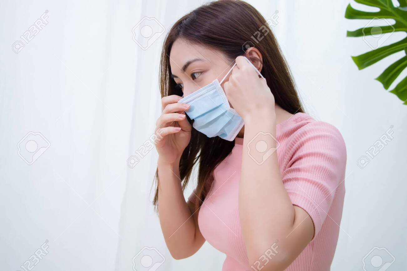 Woman suffer from cough with face mask protection. - 127575909