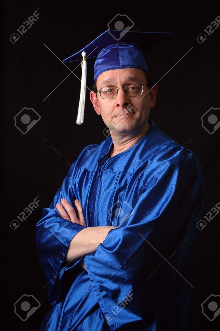 Portrait Of Man With Graduation Gown And Cap Over A Black Background ...