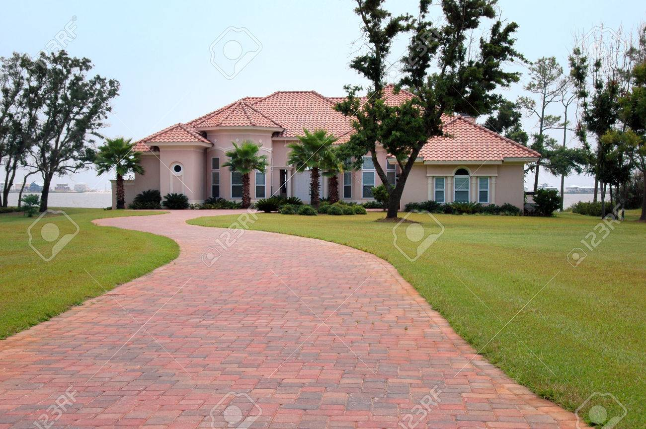 Beautiful House By The Beach With Brick Driveway Stock Photo
