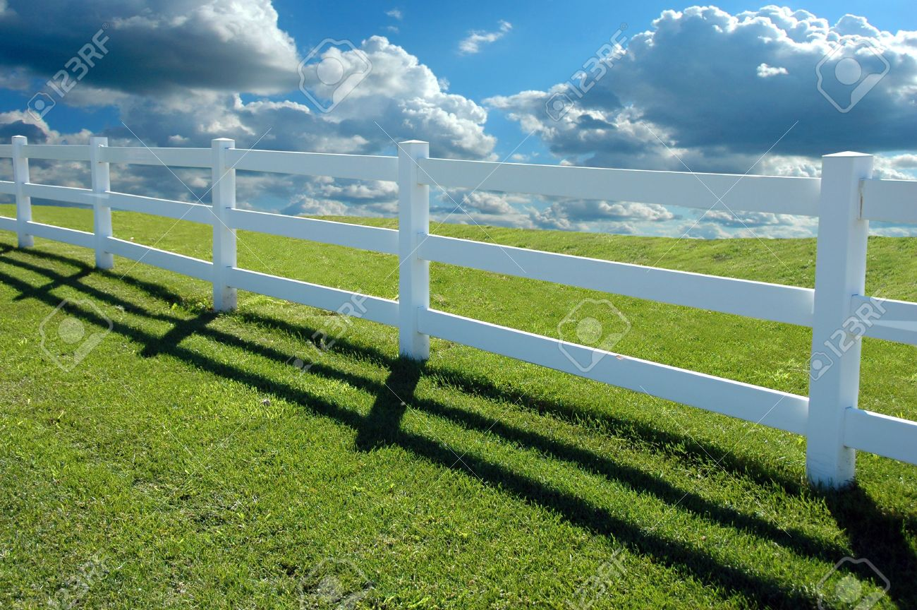 Country Fence With Clouds In Background Stock Photo